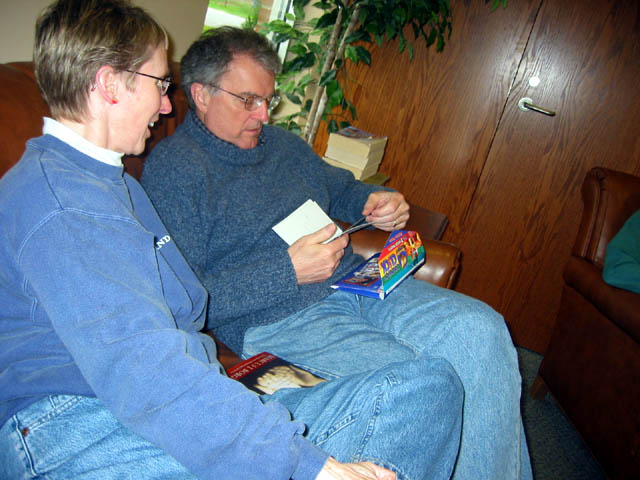 Roselyn and Mark looking at pictures